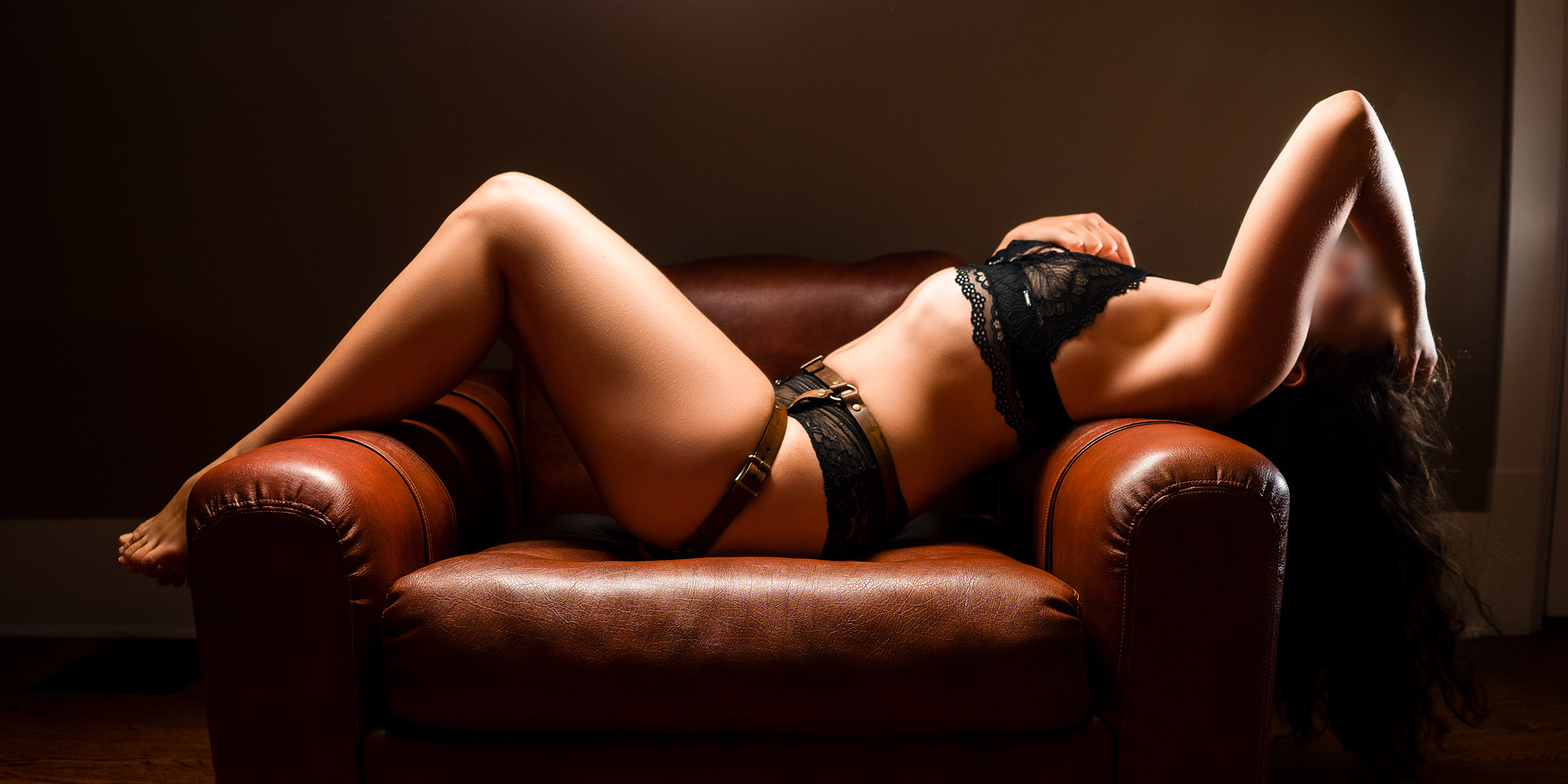 Taylor lying on a chair at Island's Finest escort agency in Victoria BC