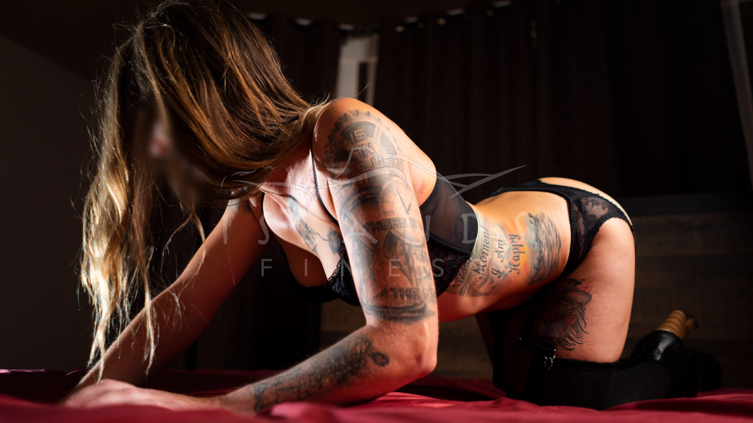 Escort Averie kneeling on a bed at Island's Finest escort agency in Victoria, BC