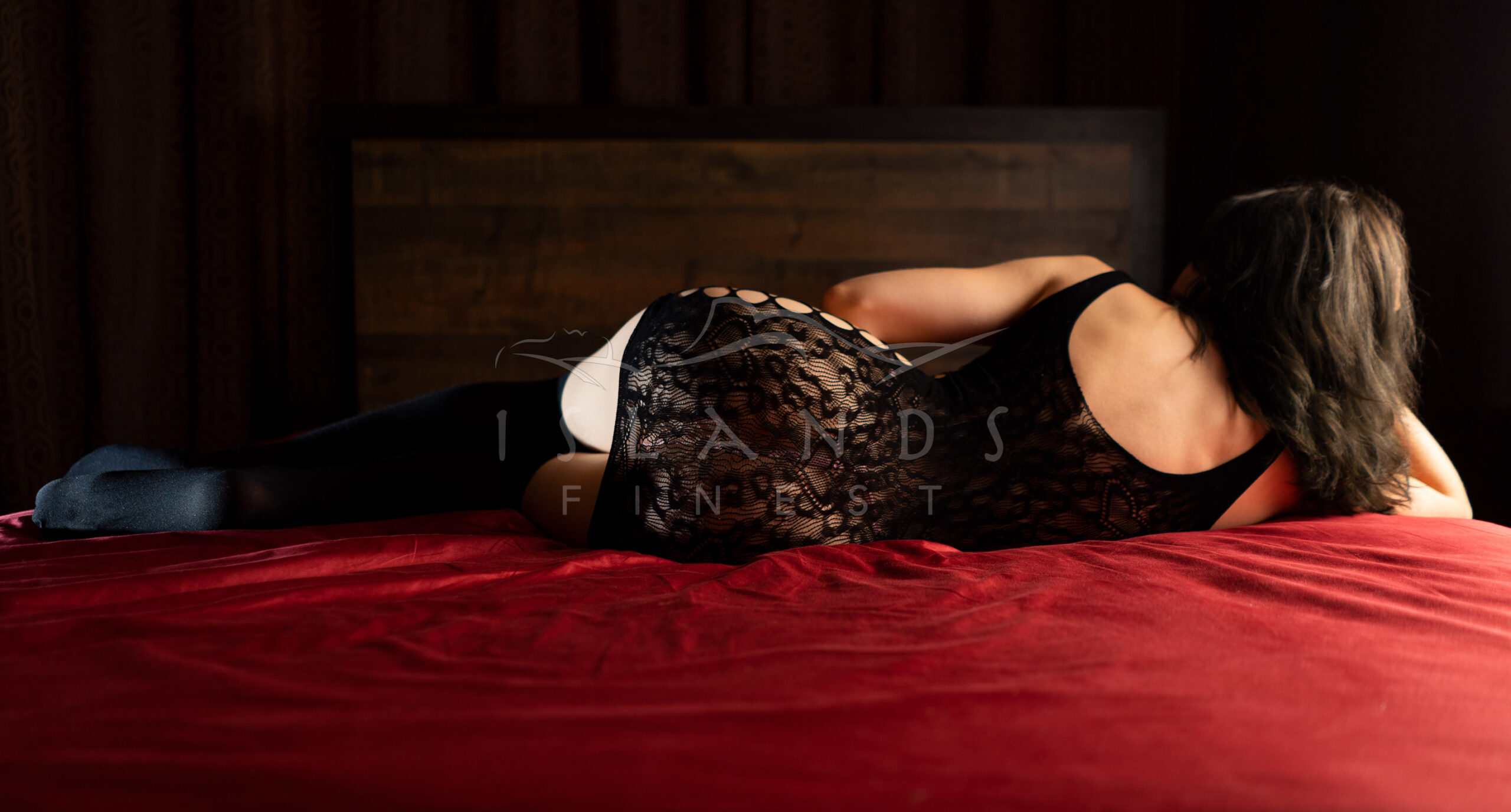 Escort Olivia lying on a bed at Island's Finest escort agency in Victoria, BC